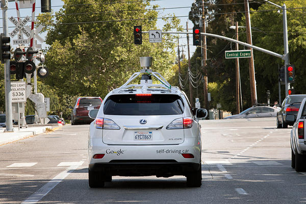 A Google driverless car navigates along a street in Mountain View, Calif. The way we get around could be significantly different in coming decades, and the environmental impacts of this new transportation economy will ultimately depend on several different factors.